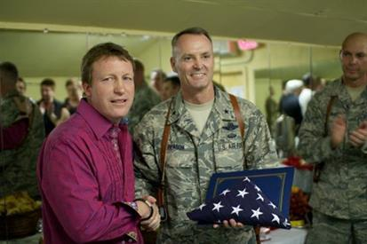 Chef Carroll received the American flag from the General during his first Operation: HOT in Afghanistan in 2011